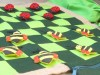 Checkers game with ladybird and bumble bee pieces